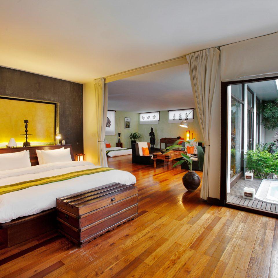 Bedroom Hot tub Hot tub/Jacuzzi Luxury Patio Resort property building home hardwood Villa wooden living room Suite wood flooring condominium cottage hard