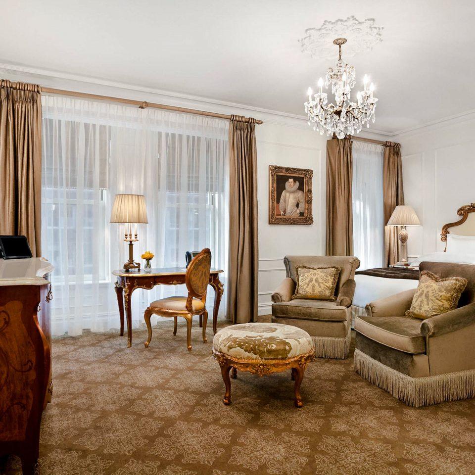 Hotels Luxury Travel Romantic Hotels chair living room property home Suite flooring interior designer Bedroom