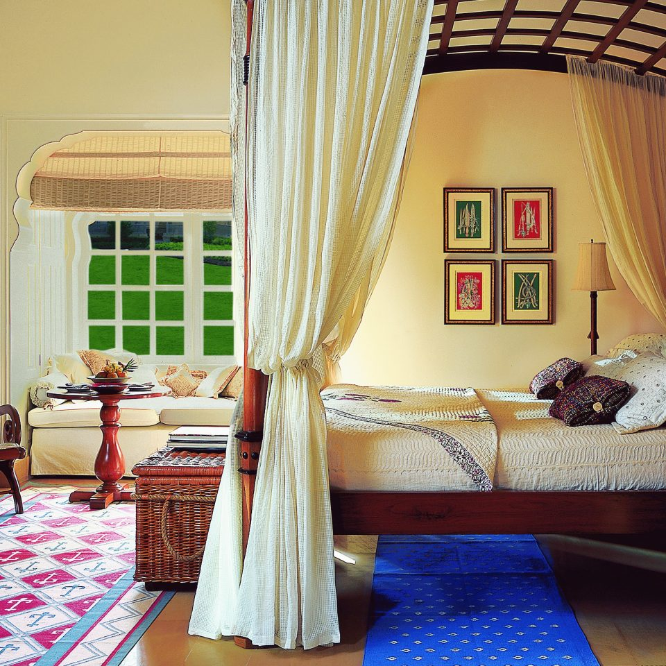 Bedroom Hotels Luxury Travel Suite property house living room home cottage curtain window treatment farmhouse Villa colorful