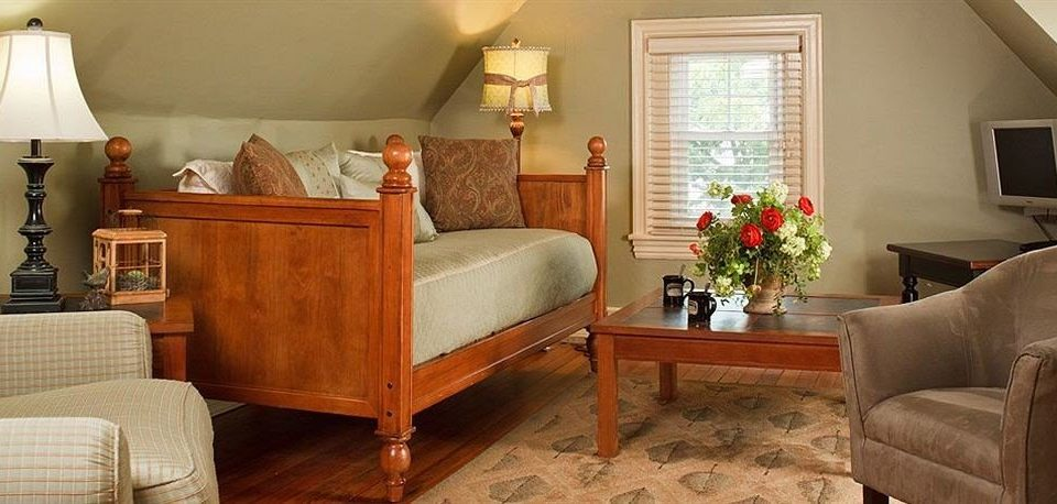 Inn property living room home Bedroom cottage hardwood Suite farmhouse leather containing