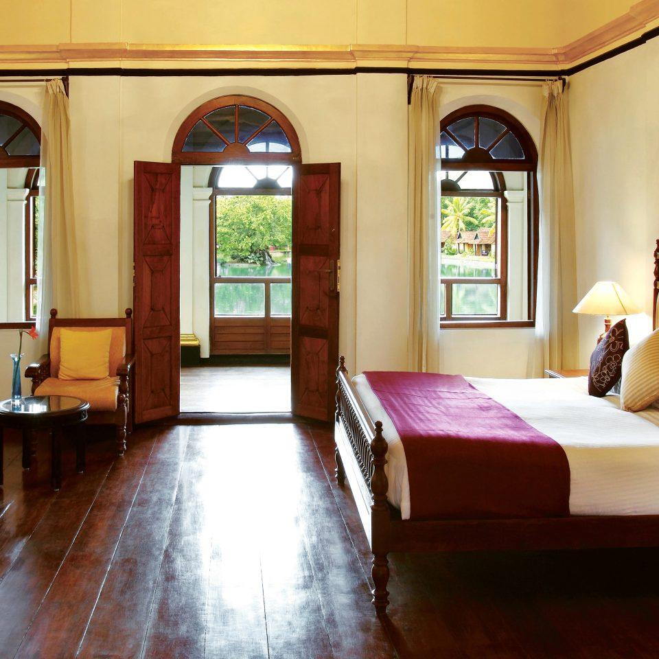Bedroom Island Lounge Waterfront property living room home hardwood mansion Suite wooden Villa cottage Lobby hard