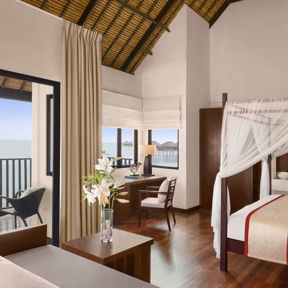 Bedroom Island Luxury Overwater Bungalow Suite property chair living room home Villa cottage