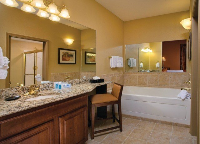 bathroom property sink home cottage hardwood counter Kitchen Suite farmhouse cabinetry vanity Bedroom tan