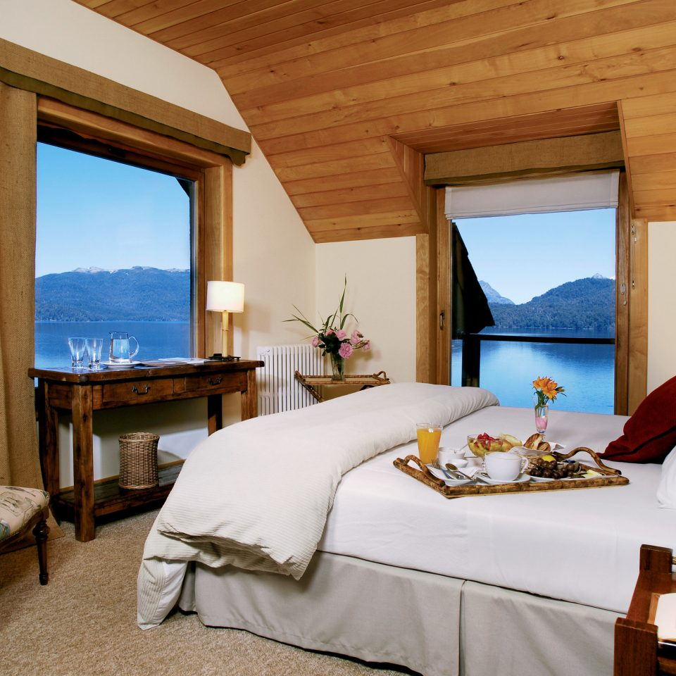 Bedroom Lake Scenic views Waterfront property Suite Resort Villa cottage home nice living room