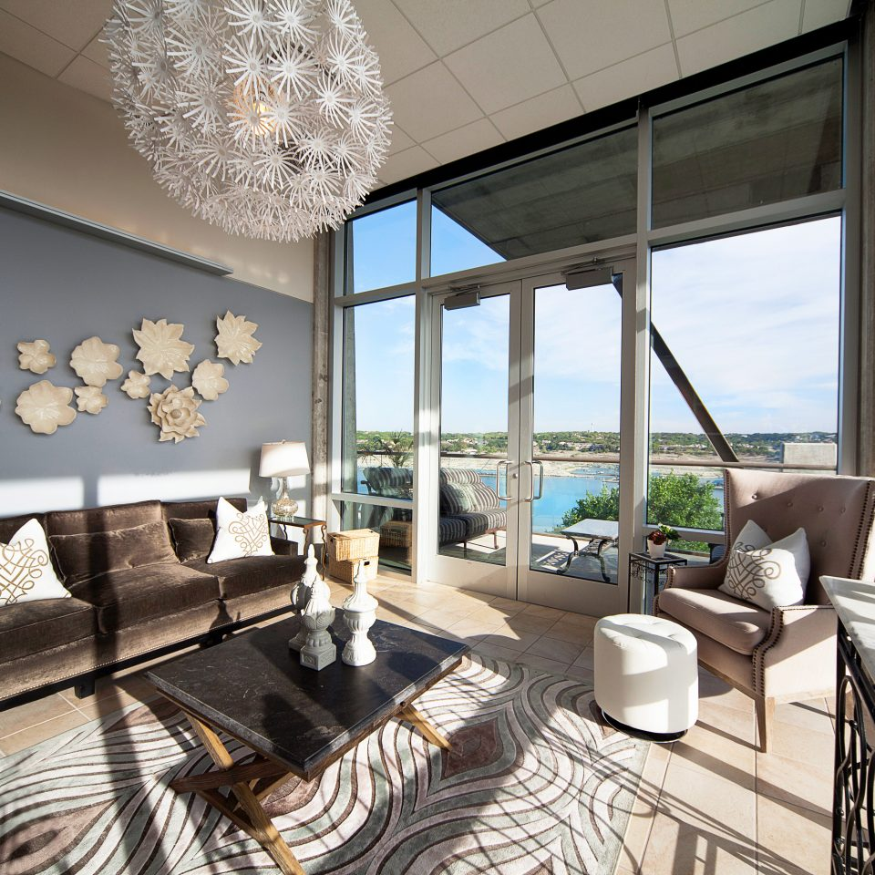 Bedroom Modern Scenic views Suite Waterfront property living room home condominium Lobby Villa