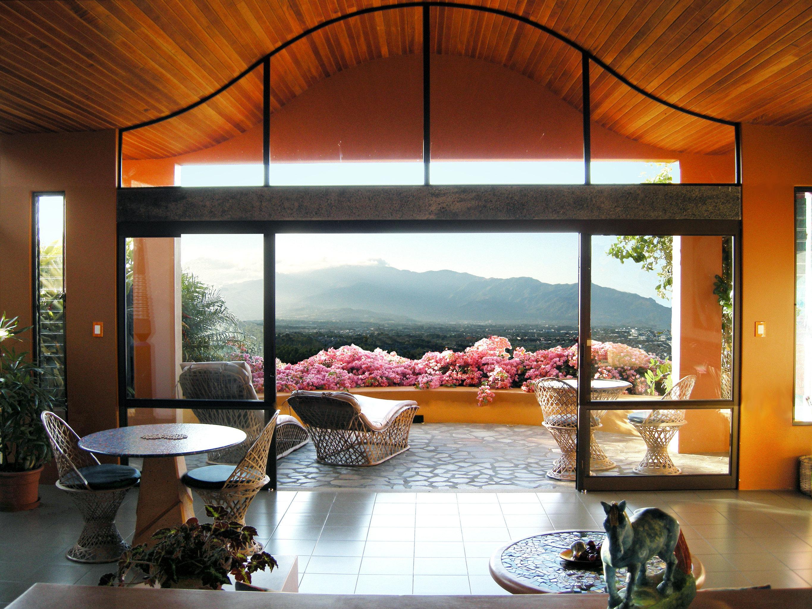Bedroom Outdoors Patio Scenic views Suite Wellness property home living room Lobby restaurant Villa condominium