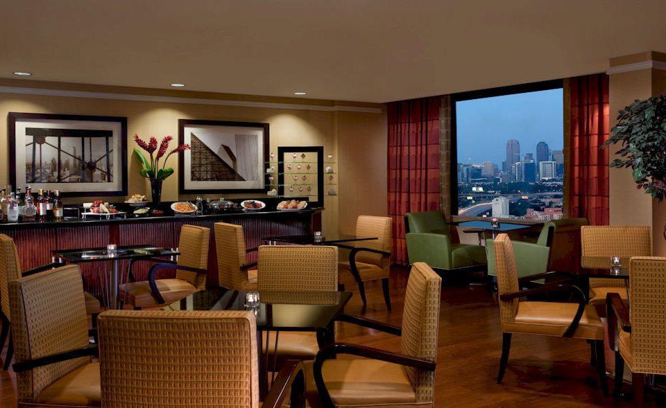 chair property Suite living room restaurant Lobby condominium Resort Bedroom