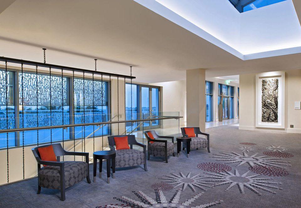 chair property house home condominium living room Resort Lobby Villa Bedroom