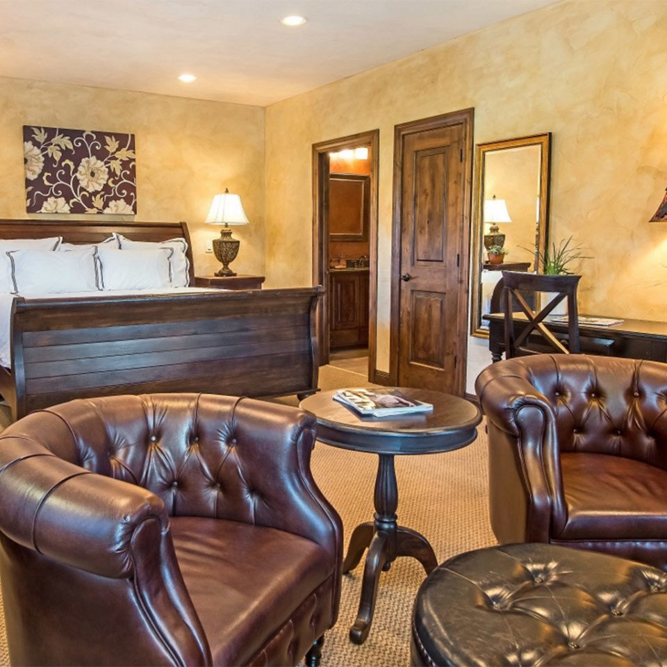 chair property living room Suite Lobby home mansion leather recreation room cottage Bedroom