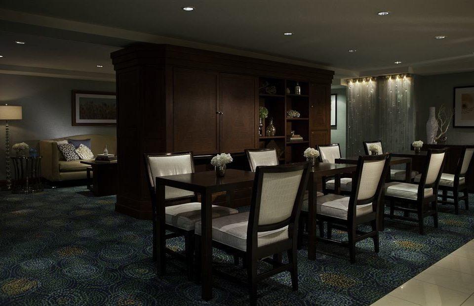 chair property Lobby living room lighting Suite restaurant condominium Bedroom dining table