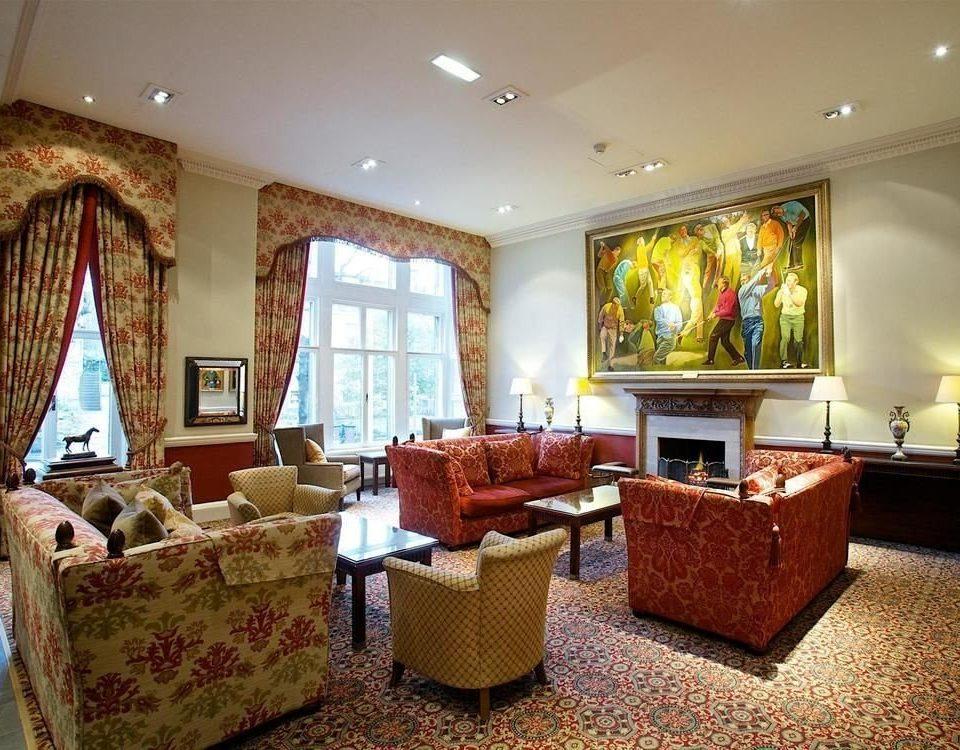 sofa property living room Suite home cottage Villa condominium mansion Bedroom Lobby recreation room