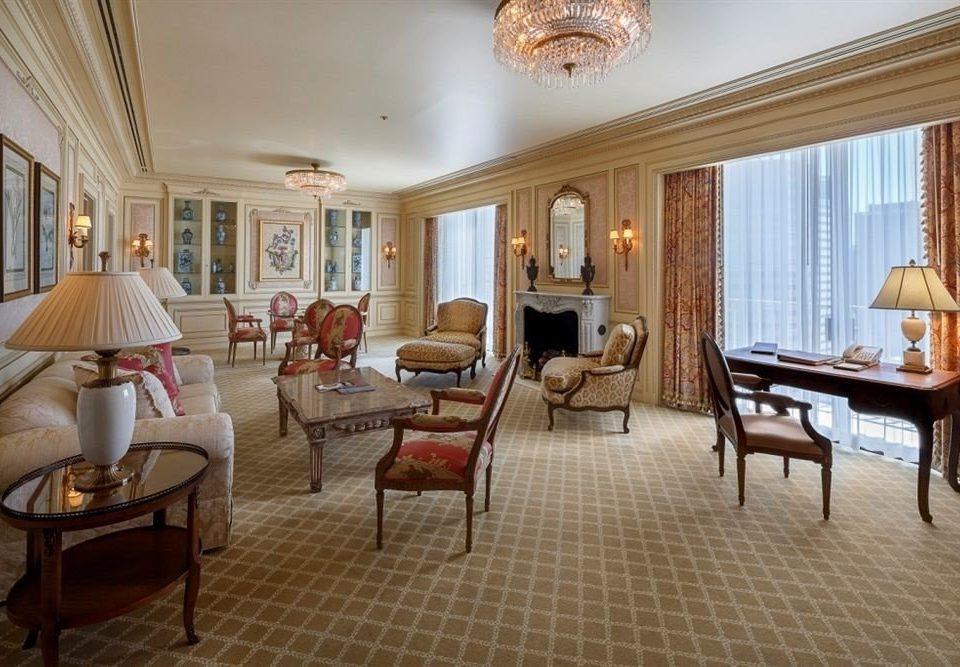 Lounge Luxury chair property Suite living room Resort Villa hardwood home cottage nice condominium mansion Bedroom