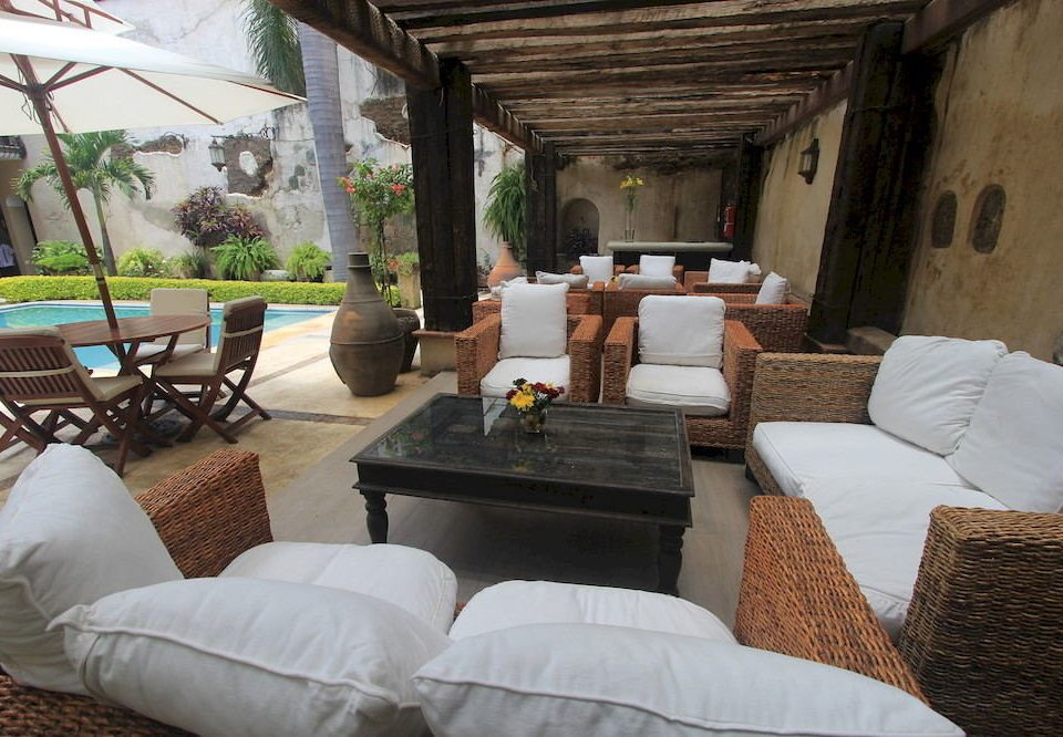 Lounge Outdoors Patio Pool Romance Rustic Terrace sofa property building Villa living room cottage home hacienda Resort backyard Bedroom