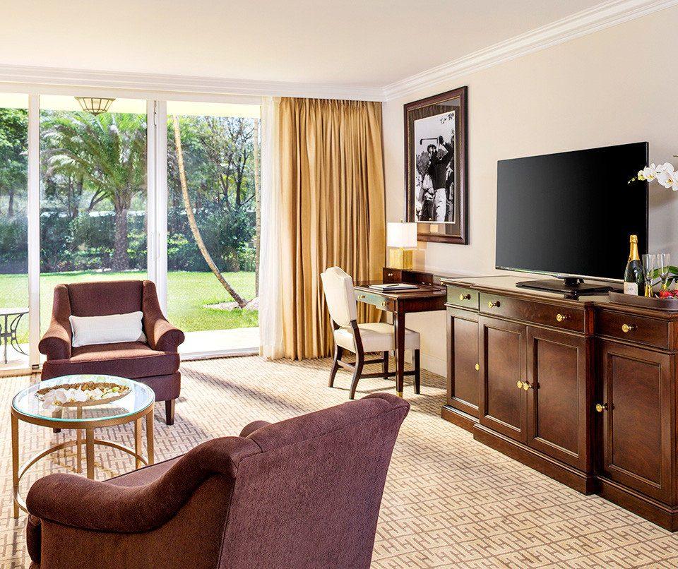 Bedroom Lounge Resort Spa Suite Waterfront property chair home living room cottage hardwood Villa condominium nice farmhouse