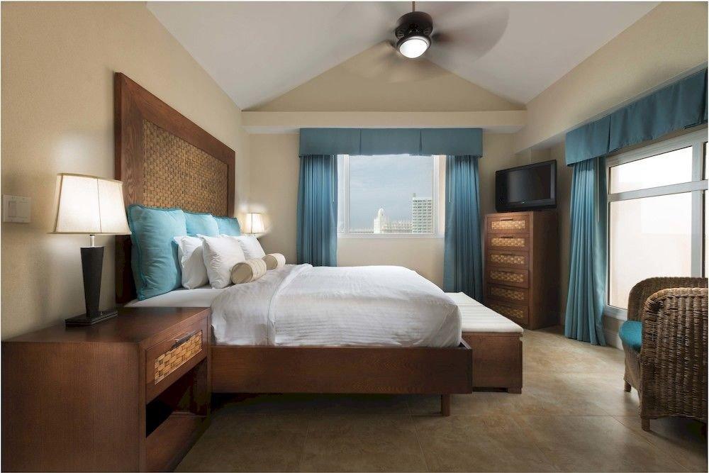 Bedroom Luxury Modern Scenic views Suite property living room condominium cottage home Villa tan
