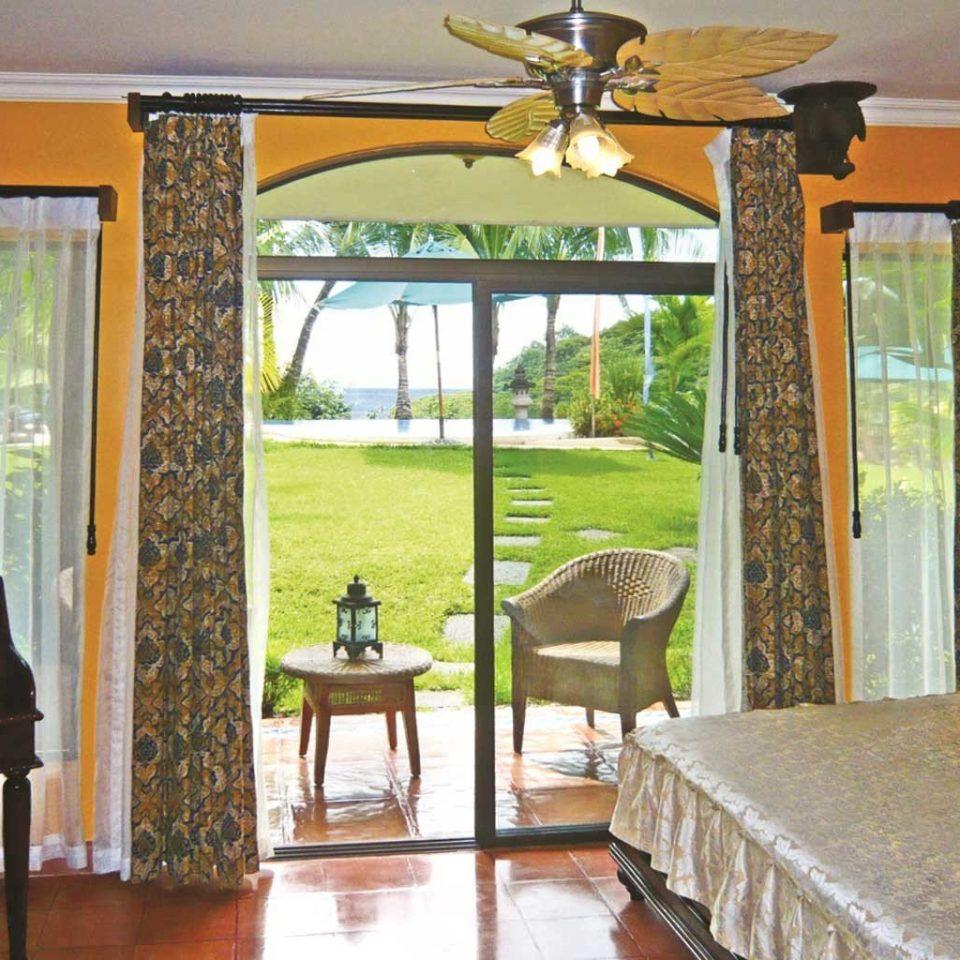 Bedroom Luxury Patio Scenic views Suite property porch cottage Villa home farmhouse Resort hacienda outdoor structure