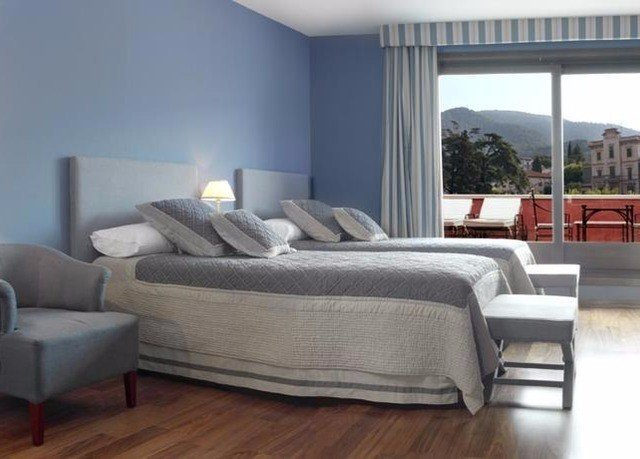 property living room hardwood Bedroom bed frame condominium studio couch bed sheet Modern