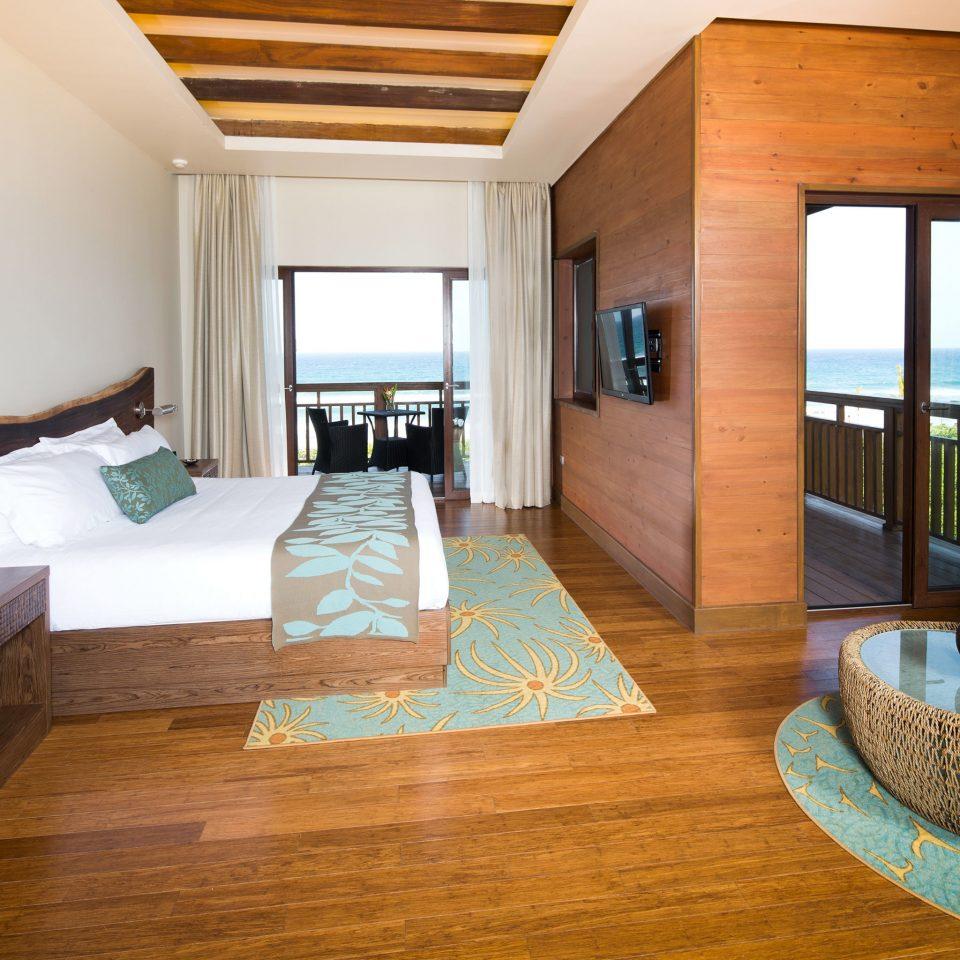 Bedroom Modern Resort property living room hardwood home Suite cottage wood flooring Villa flooring