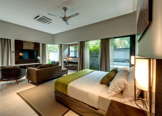 sofa property condominium Suite Bedroom living room home Resort Villa cottage Modern flat