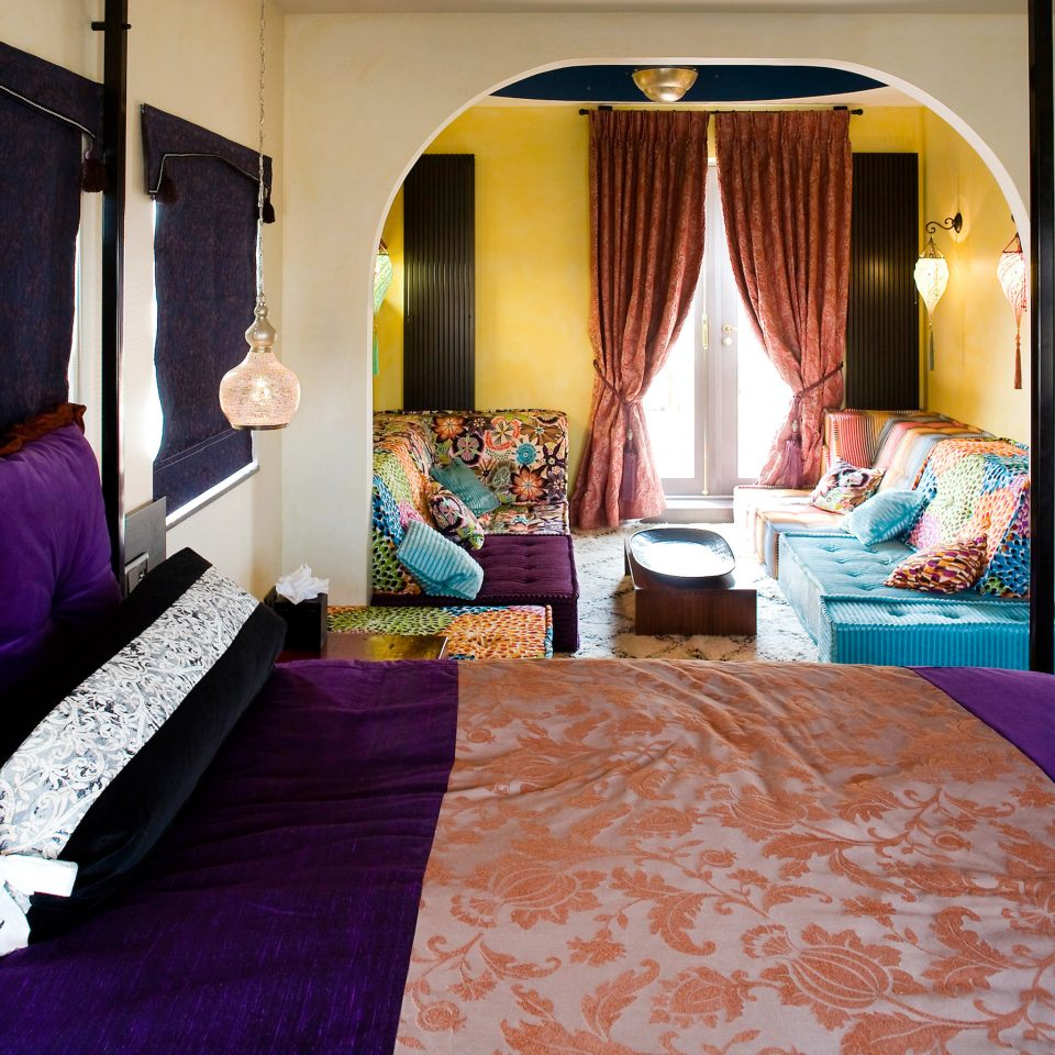 Bedroom Modern Resort Suite purple bed sheet cottage