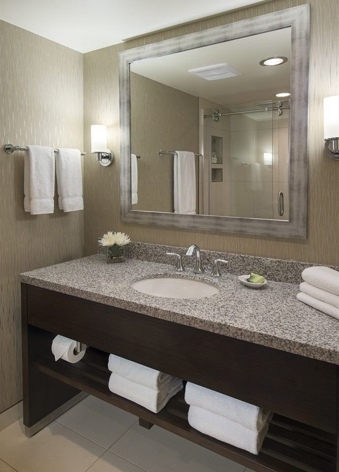 bathroom mirror sink property Suite plumbing fixture flooring vanity counter double countertop Bedroom tan Modern