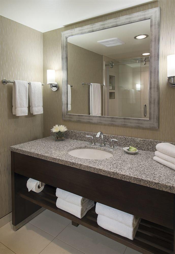 bathroom mirror sink property Suite plumbing fixture flooring vanity counter double countertop Bedroom tan Modern