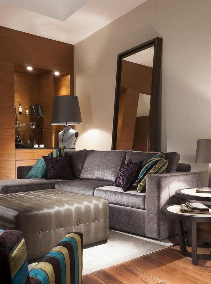 sofa living room property chair home hardwood green Suite condominium Bedroom wood flooring Modern leather