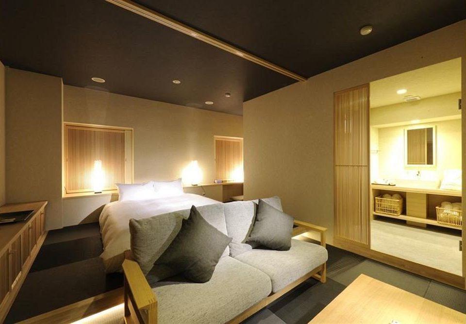 sofa property Suite living room condominium Bedroom cottage Modern flat tan