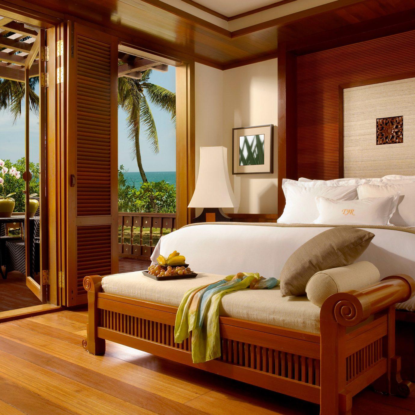 property Bedroom hardwood living room home cottage Suite wood flooring bed frame bed sheet Villa Modern