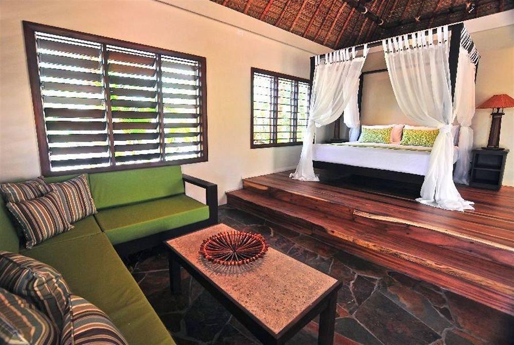 sofa property living room Suite home cottage Bedroom condominium Villa rug leather Modern