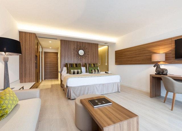 sofa property Suite hardwood home condominium cottage Villa living room wood flooring Bedroom Modern flat hard