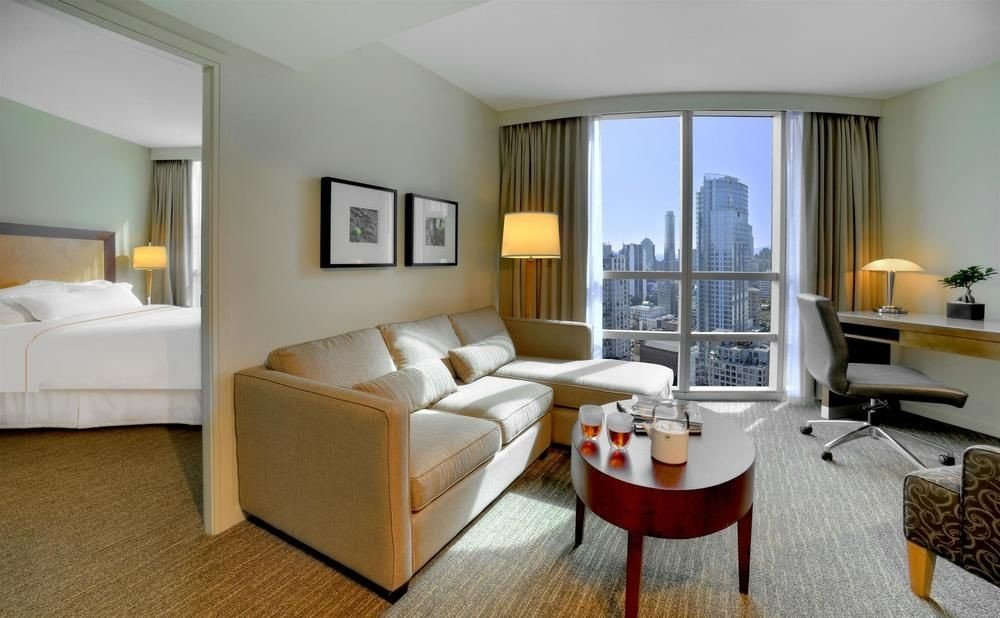 sofa property living room chair condominium Suite home Bedroom hardwood Villa cottage Modern flat