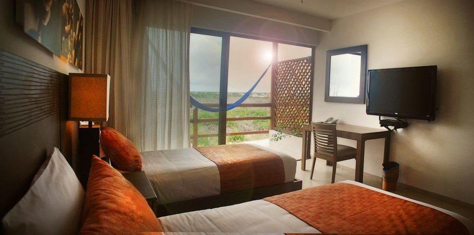 Bedroom Patio Scenic views Terrace sofa property Suite living room home cottage condominium flat