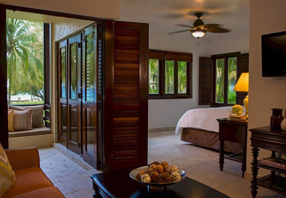 Bedroom Resort Scenic views Tropical Waterfront property home Suite hardwood cottage living room Villa condominium