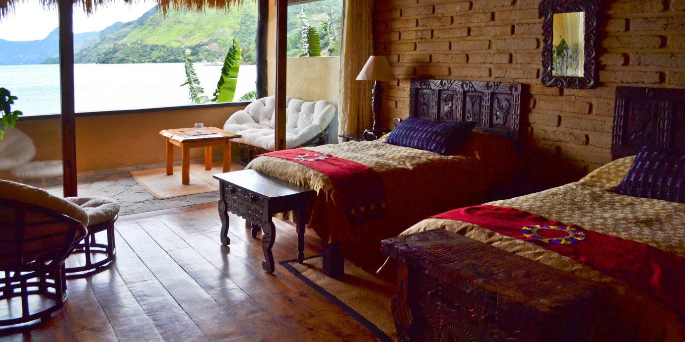 Solo Travel Trip Ideas property building cottage home Suite Resort Villa farmhouse Bedroom