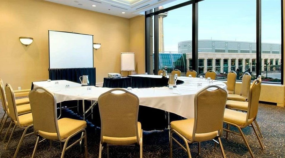 chair property desk conference hall restaurant function hall Suite convention center Resort meeting Bedroom dining table