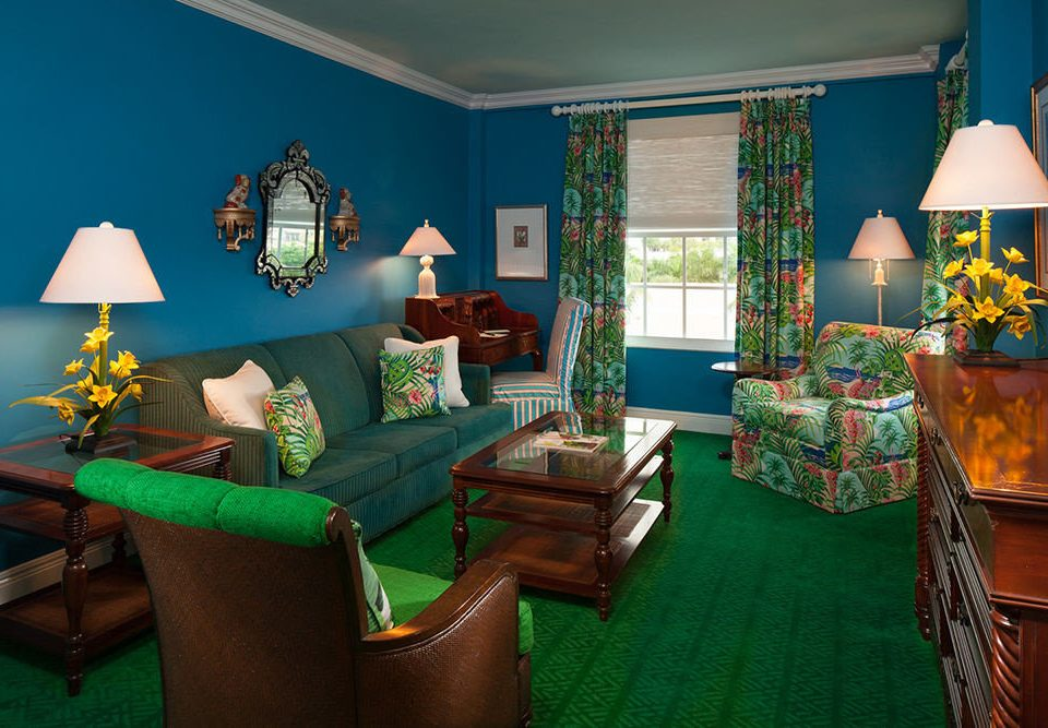 sofa green living room property house recreation room home screenshot cottage Suite Resort Bedroom colored