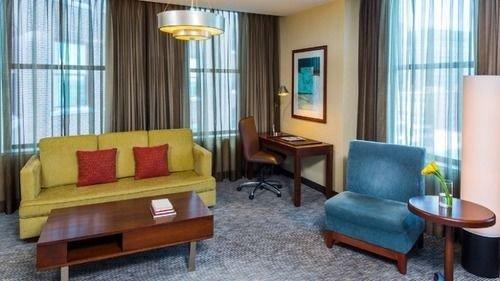 sofa property Suite condominium living room cottage Resort Bedroom lamp containing