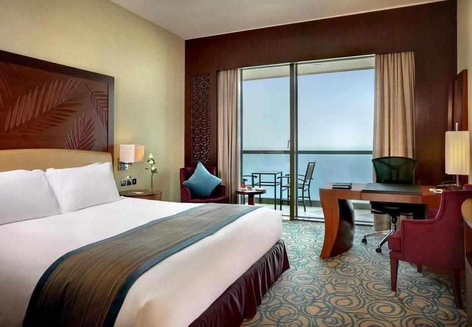 Bedroom sofa property Suite Resort condominium cottage lamp