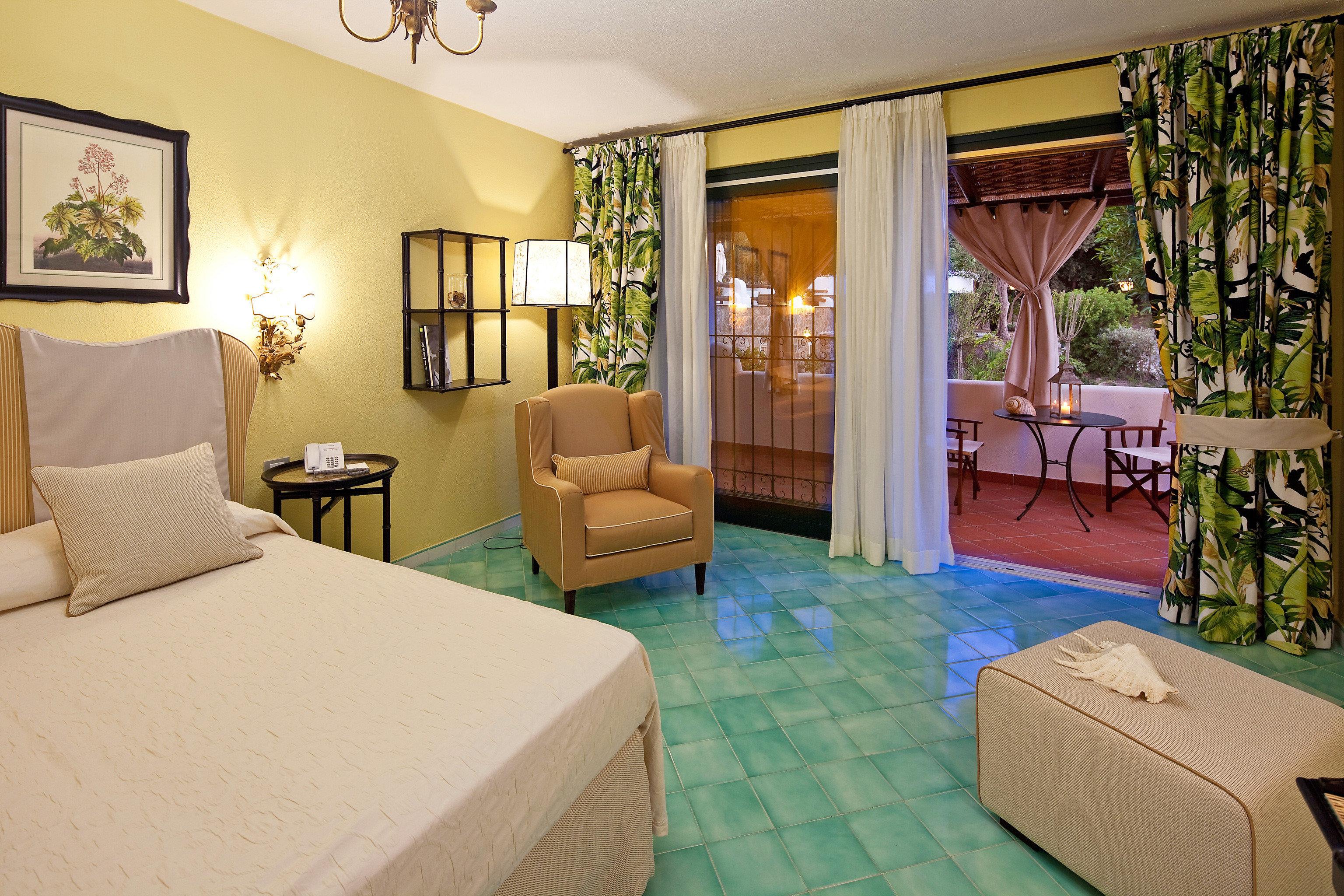 Bedroom Tropical property green condominium Suite Villa home cottage living room Resort