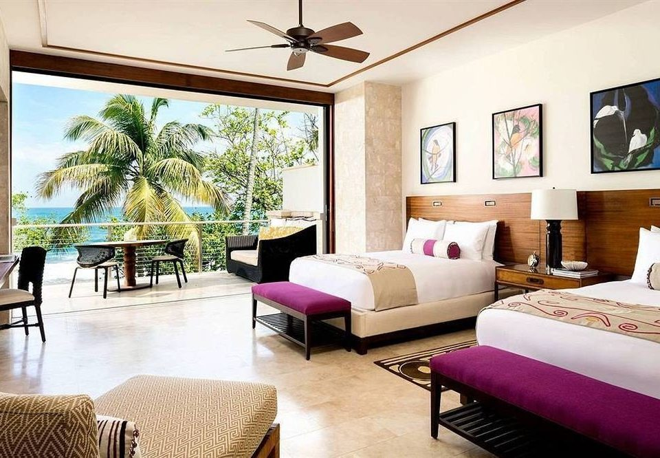 sofa property living room Resort Suite home condominium Villa cottage Bedroom