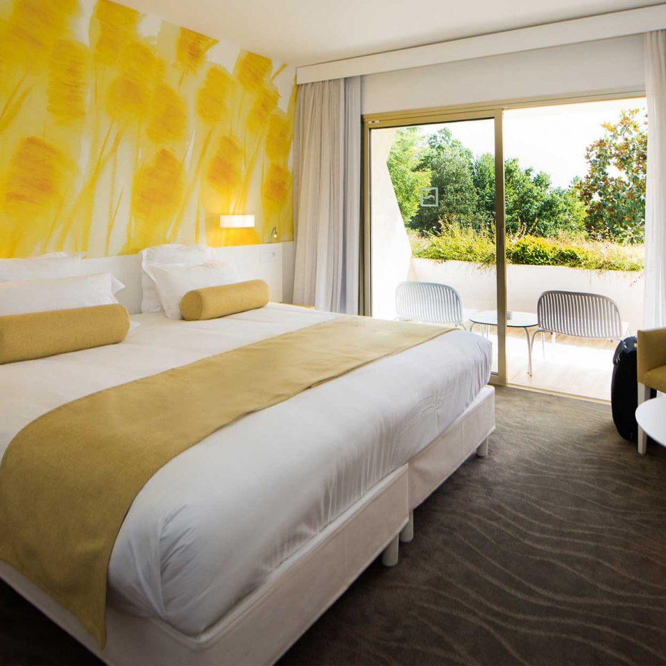 sofa property Bedroom Suite yellow Villa cottage living room Resort condominium
