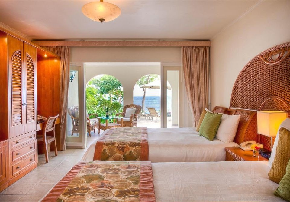 sofa property living room Suite home cottage Villa Bedroom Resort condominium