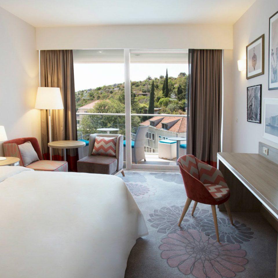sofa property Suite home condominium living room Resort cottage Villa flat Bedroom