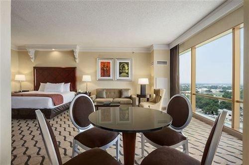chair property condominium Suite living room Resort cottage Villa Bedroom dining table
