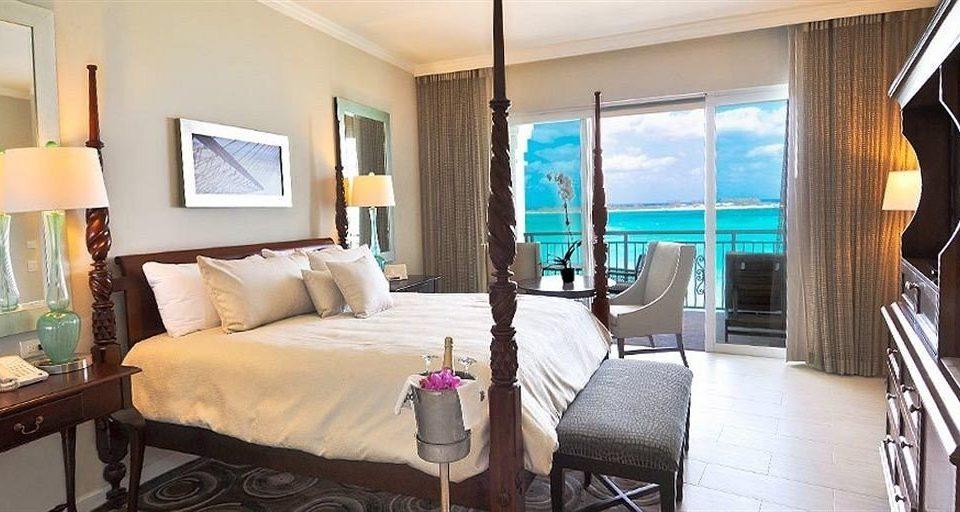 chair property Suite Villa living room home cottage Resort condominium Bedroom