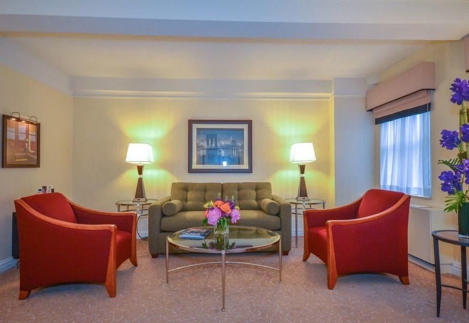 chair property red Suite living room Villa home condominium cottage Resort Bedroom