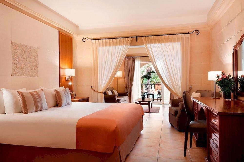sofa property Suite Resort Villa Bedroom living room
