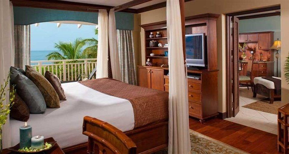 property home Suite cottage Villa Resort Bedroom condominium hardwood living room mansion farmhouse dining table