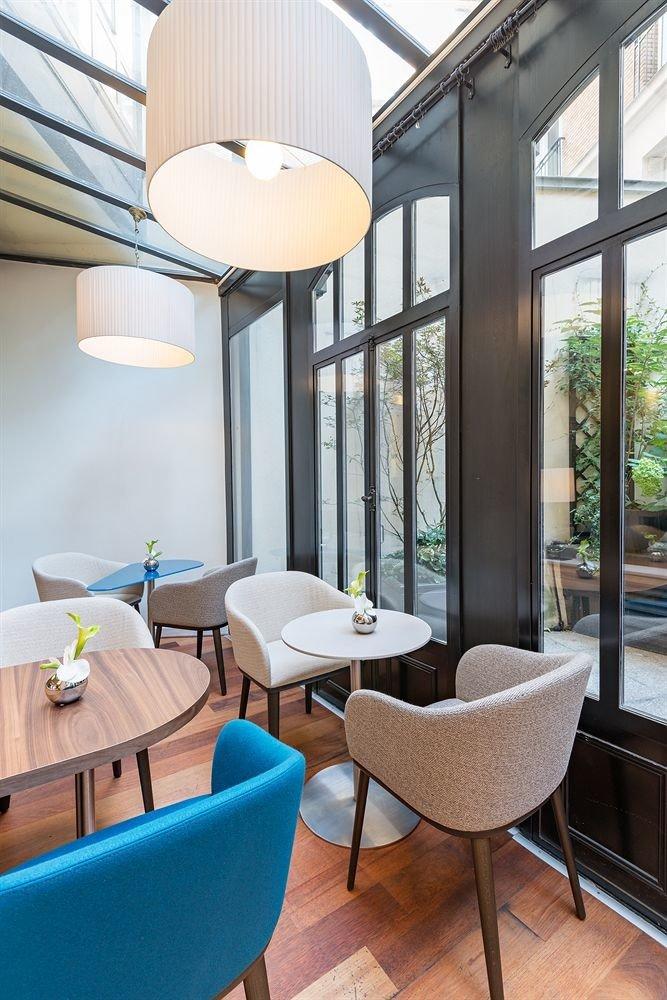 chair property condominium living room home daylighting Suite Resort Villa Bedroom